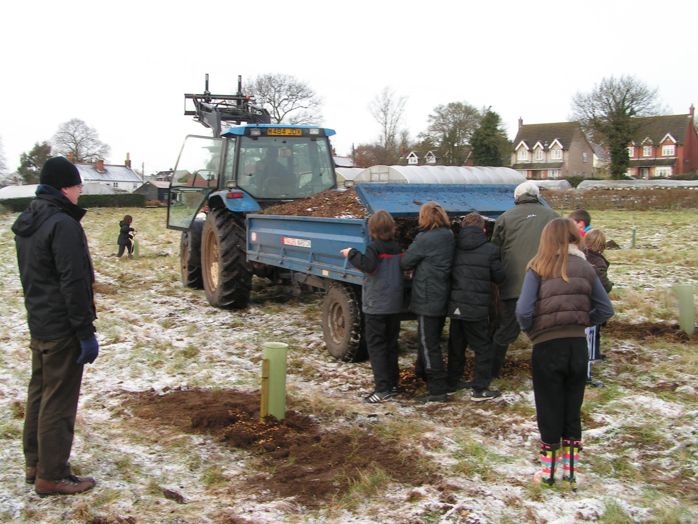 Helping to plant the community orchard at Merton Wood 2012